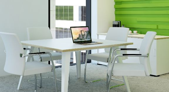 small conference table with white chairs